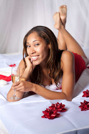 African American Woman in Sexy Red Lingerie With Champagne in Fluke photo