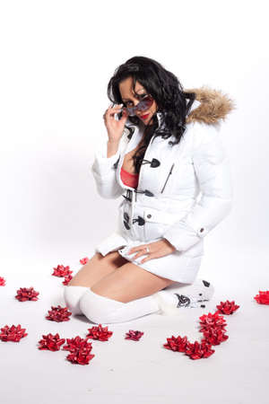 Latina Woman in White Puffy Coat With Red Lingerie photo