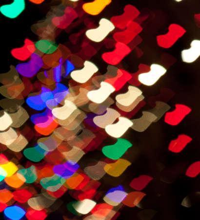 Red, White, Blue, Green, Pink, Yellow Christmas Stocking Lights Bokeh Stock Photo