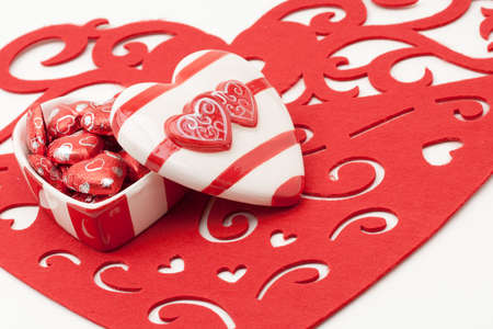 Red and White Heart Shaped Valentine Ceramic Box With Chocolate Hearts photo