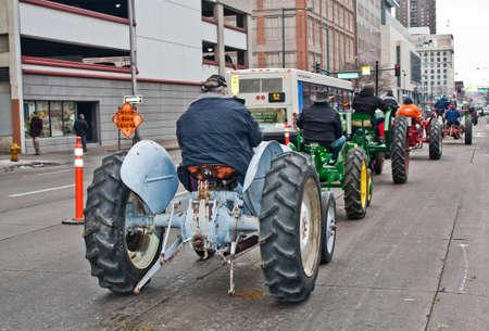 bridget calip: Denver, Colorado January 10, 2013 National Western Stock Show Parade   Vintage Tractors Driven By Cowboys Down Denver City Streets Editorial