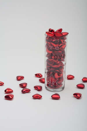 Valentines Day Love Vase Filled With Red Hearts Stock Photo