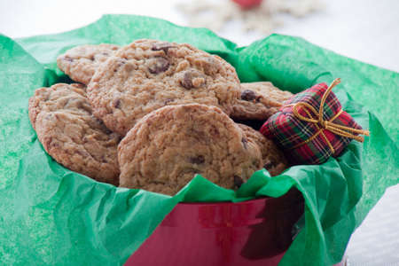 Chocolate Chip Cookies in a Red Tin With Green Tissue Paper and a Plaid Present