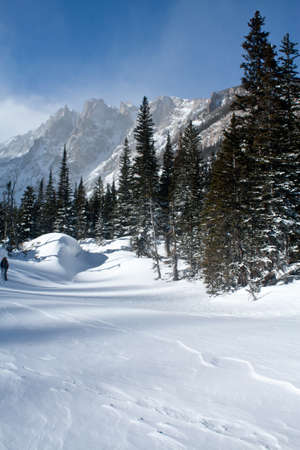 dream lake: Snow Covered Dream Lake on a Frigid, Sunny Winter Morning in Rocky Mountain National Park Stock Photo