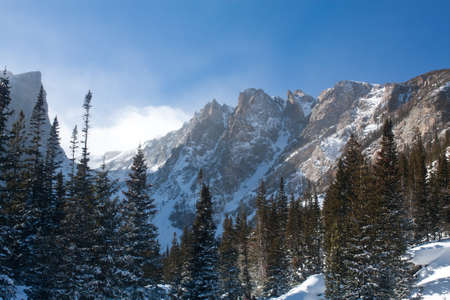 bridget calip: Snow Covered Hallett Peak From Dream Lake Area on a Sunny Winter Morning in Rocky Mountain National Park