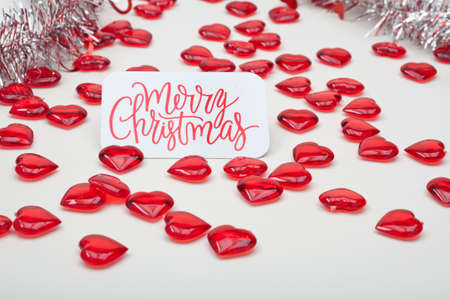 Red Hearts and Silver Garland With Merry Christmas Card Stock Photo