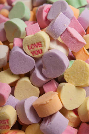 Yellow Love You Conversation Hearts Candy on Colorful Assortment of Conversation Hearts