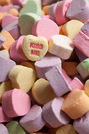 Yellow Kiss Me Conversation Hearts Candy on Colorful Assortment of Conversation Hearts