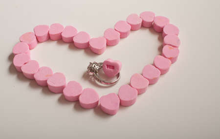 Pink Candy Hearts With Ring and Yes Conversation Heart Stock Photo