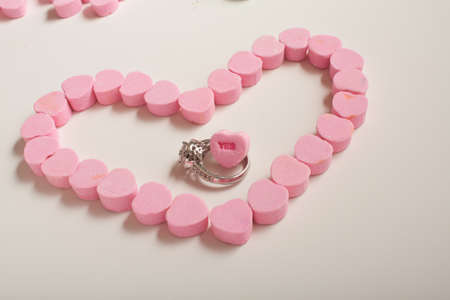 bridget calip: Pink Candy Hearts With Ring and Yes Conversation Heart Stock Photo