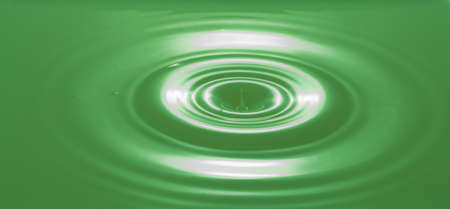'phallic symbol': Green Colored Water Splashing With Ripples