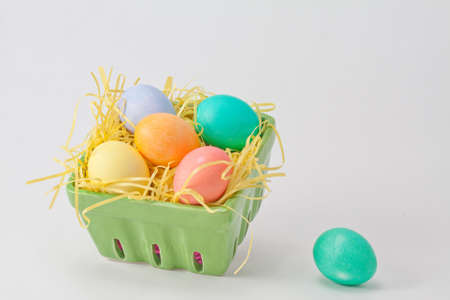 Multicolored Easter Eggs in Green Crate With Yellow Grass Stock Photo - 18533594