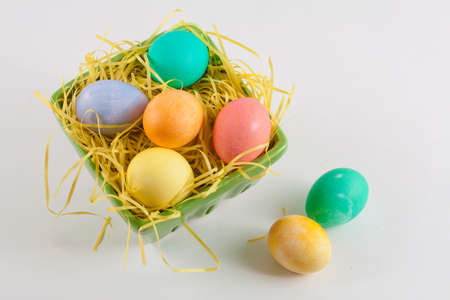 Multicolored Easter Eggs in Green Crate With Yellow Grass Stock Photo - 18533630