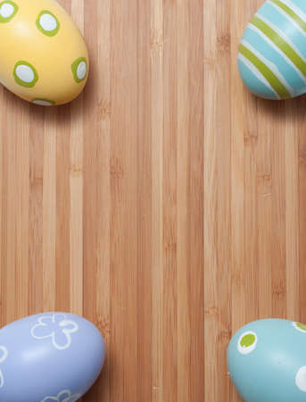 Hand Painted Easter Eggs in Pastel Colors on Wooden Cutting Board