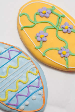Easter Cookies in the Shape of an Egg Decorated with Blue and Yellow Frosting Stock Photo - 18533635