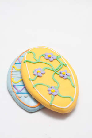 Easter Cookies in the Shape of an Egg Decorated with Blue and Yellow Frosting Stock Photo