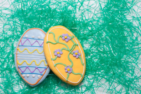 Easter Cookies in the Shape of an Egg Decorated with Blue and Yellow Frosting Stock Photo - 18533640