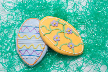 Easter Cookies in the Shape of an Egg Decorated with Blue and Yellow Frosting Stock Photo - 18533641