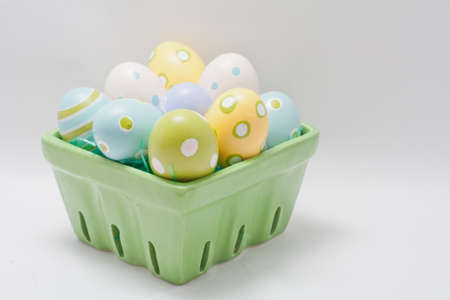 Hand Painted Pastel Colored Easter Eggs in a Green Crate