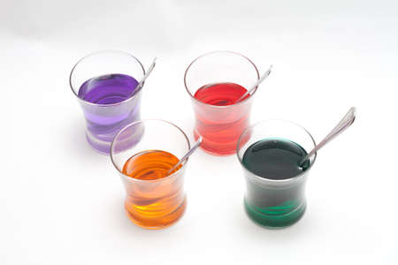 Red, Purple, Blue, Orange, Yellow and Green Easter Egg Dye Stock Photo