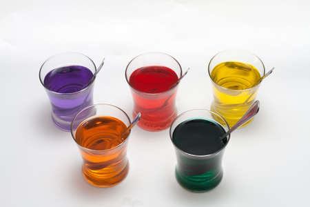 Red, Purple, Blue, Orange, Yellow and Green Easter Egg Dye Stock Photo - 18533625
