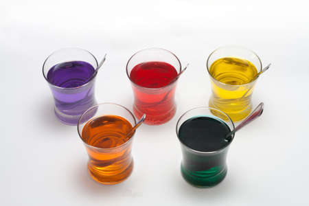 Red, Purple, Blue, Orange, Yellow and Green Easter Egg Dye Stock Photo - 18533620