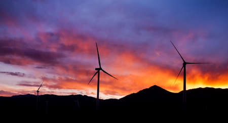 Three Blade Wind Turbines With Purple Mountains Majesty Sunset Stock Photo - 18653381