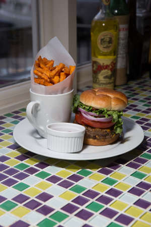 all american burger: Gourmet Cheeseburger With Red Onion, Lettuce, Hand Cut Sweet Potato Fries and Ketchup