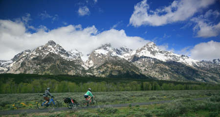 Family Consisting of Dad, Mom and Child Biking in the Grand Tetons, Rocky Moutains, Wyoming