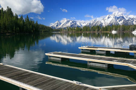 Wooden Docks on a High Rocky Mountain Lake in the Grand Tetons, covered with snow photo