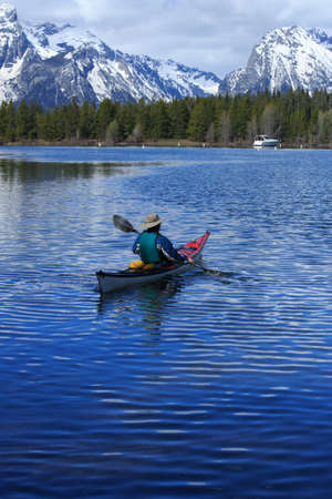 Man Kayaking in the Rocky Mountains photo