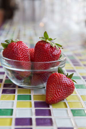 Fresh Strawberries in a Clear Bowl with Mosaic Tiles