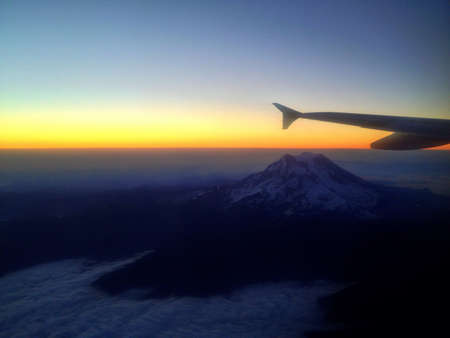 Mt. Rainier Above the Clouds at Sunrise From an Airplane