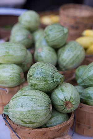 Fresh Organic Green Calabacitas in Wooden Baskets at the Farmers Market