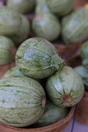 bridget calip: Fresh Organic Green Calabacitas in Wooden Baskets at the Farmers Market
