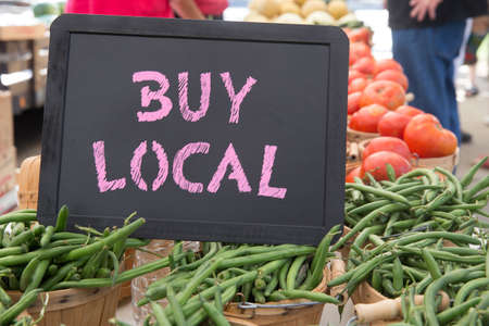 Buy Local Chalkboard Sign With Bushels of Green Beans, Tomatoes and Onions For Sale at the Farmers Market Stock Photo