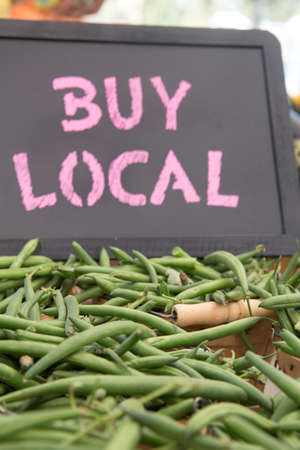 Hand Picked Green Beans, Onions and Egg Plant in Brown Basket With Buy Local Chalkboard Sign