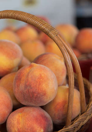 Fresh Peaches From the Farm in a Basket Stock Photo