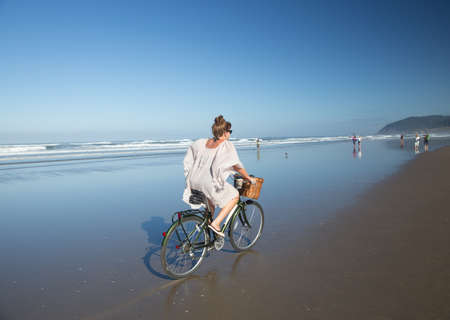 Woman Bicycling on the Beach