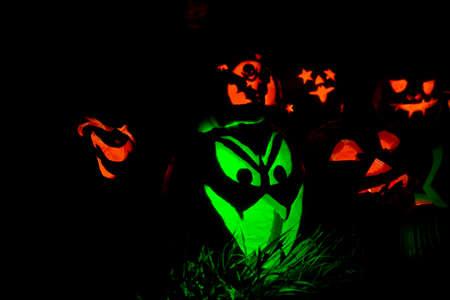 Green Jack-O-Lantern With Fangs and Orange Dracula Pumpkin