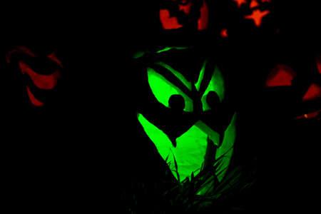 Jack-O-Lanterns Carved for Halloween Lit in Orange and Green