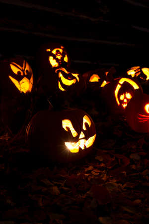 Jack-O-Lanterns Carved for Halloween Lit in Orange Stock Photo