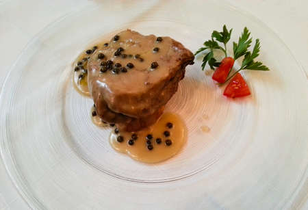 Beef Tenderloin with Green Pepper Cream Sauce