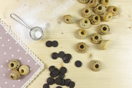junk: Small donuts on wood background - top view Stock Photo