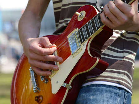 gitar: Gitar with finger on it playing chords