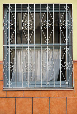 lattice window: first door window protected with iron lattice Stock Photo