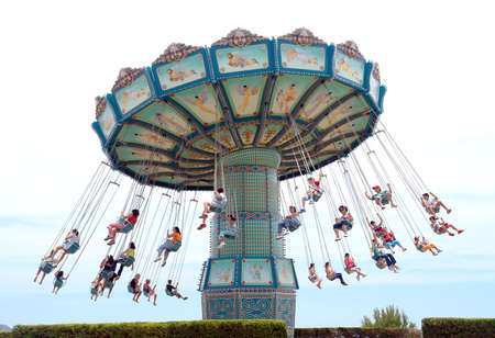 carrousel: people having fun with riding a modest carrousel Stock Photo