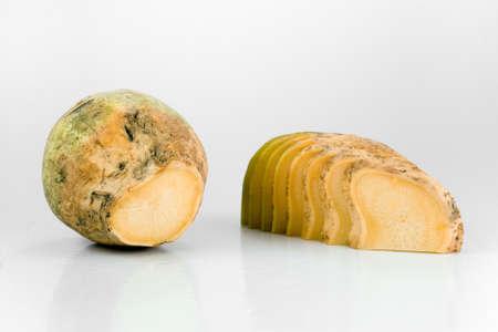 rutabaga: Fresh yellow turnip with some slices of it Stock Photo