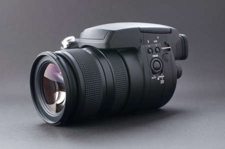 cmos: Modern Digital Camera with high Quality Fast Zoom Lens Stock Photo