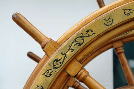 rudder ship: Old Sailing Yach Wheel with Patterns Stock Photo